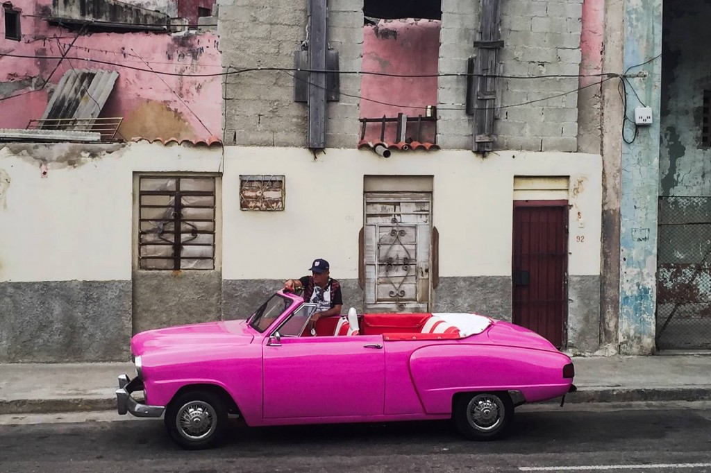 pink car Cuba decrepit background