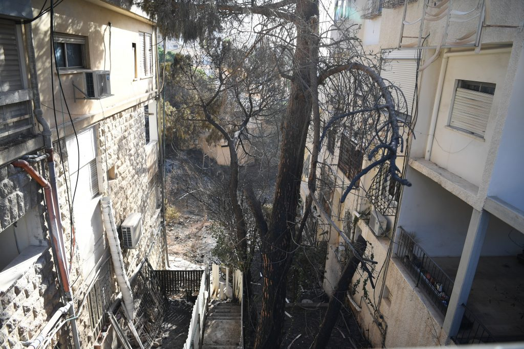 Fire damage to apartment buildings in Haifa.